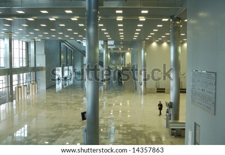 modern office interior, moving crowd,silhouettes - stock photo
