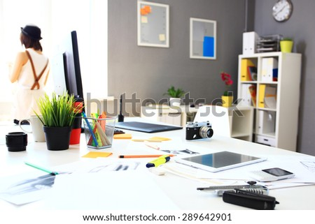 Modern office interior with tables, chairs and bookcases - stock photo