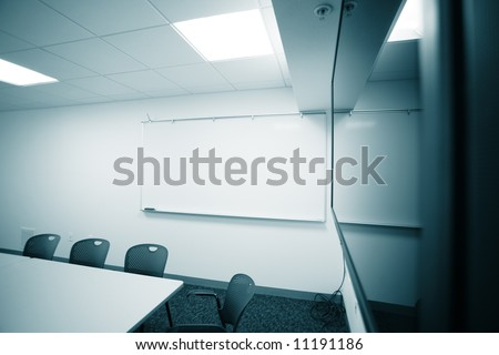 Modern office room interior with big flat presentation tv screen. - stock photo