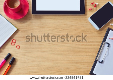 Modern office table background with table, smart phone, notepad and coffee cup. View from above with copy space - stock photo
