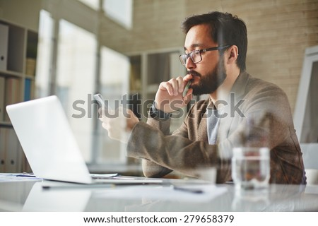 Modern office worker writing sms - stock photo