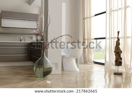 Modern open-plan kitchen with built in hob on an open counter facing a large bright window and wall mounted built in cabinets and appliances, grey and white interior decor - stock photo