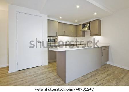 modern open plan kitchen with smart counter and built in electric appliances - stock photo