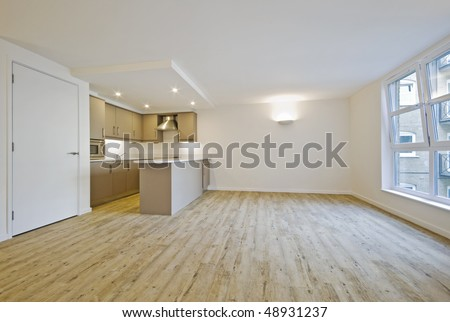 modern open plan living room in a warehouse conversion - stock photo