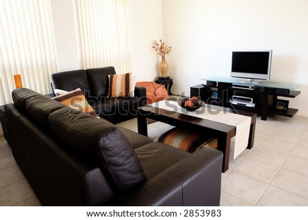 Modern orange and brown interior with home entertainment system - stock photo