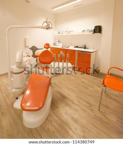 Modern orange dentist cabinet - stock photo