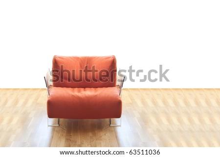 Modern orange sofa on wooden floor against white background - stock photo