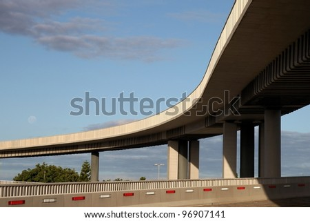 Modern overhead concrete highway road suspended on concrete columns