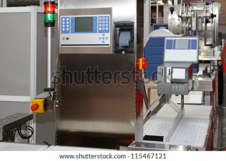 Modern packaging machine at production line in factory