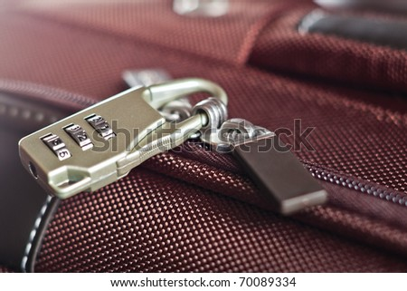 modern padlock closeup on brown suitcase