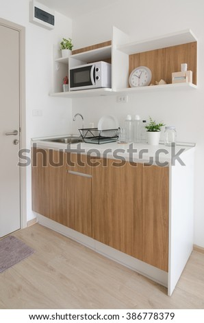 Modern pantry with utensil and sink in apartment - stock photo