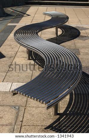 Modern park bench in Peckham, London - stock photo