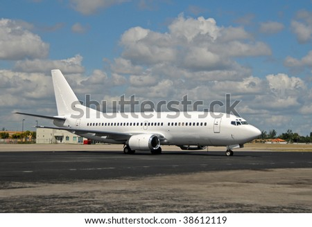 Modern passenger jet parked on the ground - stock photo