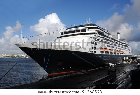 Modern passenger ocean liner docked in port - stock photo