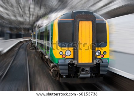 Modern Passenger Speed Commuter Transport Train in the Station with Motion Radial Zoom Blur - stock photo