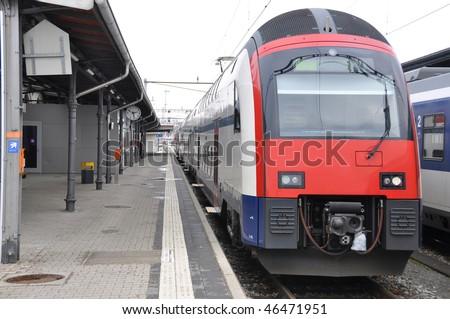 Modern passenger train at a station - stock photo