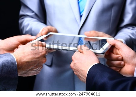 Modern people doing business  being demonstrated on the screen of a touch-pad - stock photo