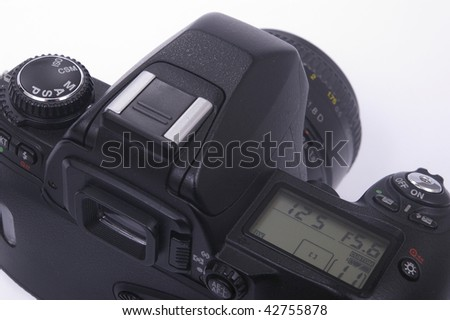 Modern photo camera SLR with lens on white - stock photo
