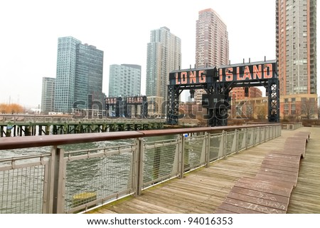 "Modern pier with ""Long Island"" painted on in Gantry Plaza State on foggy day, Queens, New York. - stock photo"