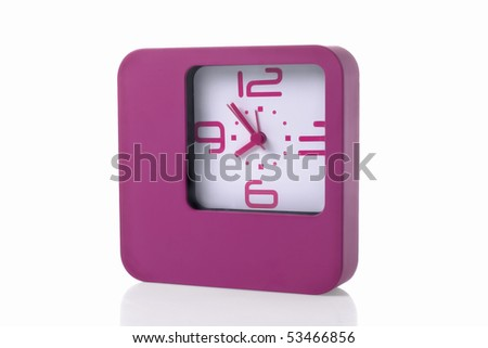 Modern pink alarm clock isolated on white background with clipping path - stock photo