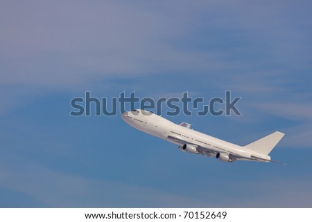 Modern Plane 747-400 on the blue sky background - stock photo