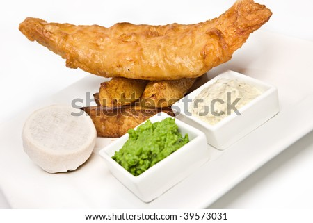 Modern Plate of traditional fish and chips - stock photo