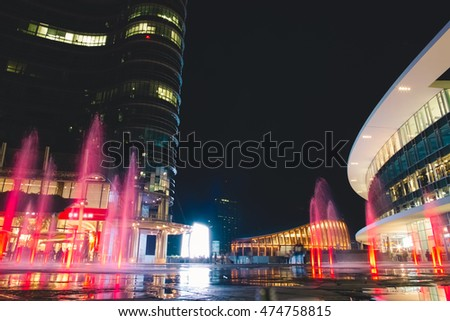 Modern Plaza and Colorful Fountains by Night