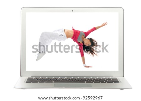Modern popular laptop with woman dancing dancer pose on a white digital screen background