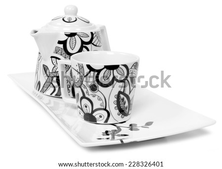 modern porcelain tea set isolated on white - stock photo