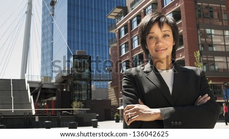Modern portrait of a young professional business woman in urban setting. - stock photo