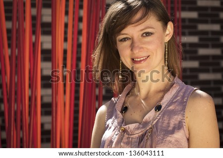 Modern portrait of a young professional business woman in urban setting.