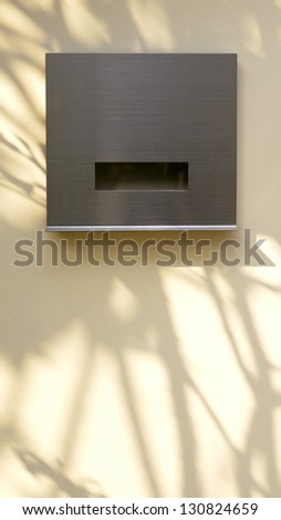Modern Post Box with Tree Shadow on Wall - stock photo