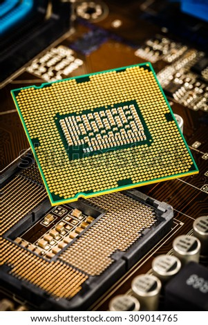 Modern processor and motherboard for a home computer - stock photo