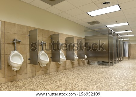 Modern Public bathroom with ceramic floors - stock photo
