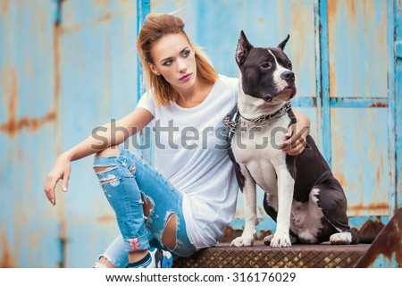 modern punk fashion, portrait of a beautiful model posing on the street with dog.  Modern Youth Lifestyle Concept - stock photo