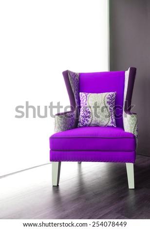 Modern purple armchair - stock photo