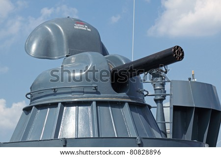 Modern rapid-fire cannon on the deck of a ship of war