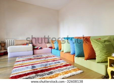 Modern Rattan Sitting Room with Wooden Floors, with colorful rattan seating in an L-shape - stock photo