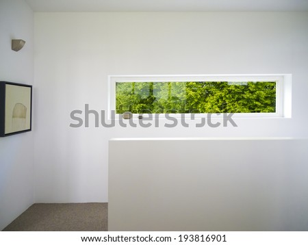 modern rectangular white wooden window with view to the garden - stock photo