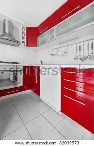 Modern red and white kitchen - stock photo