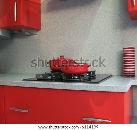 Modern red and white kitchen interior - stock photo