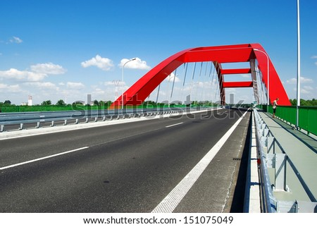 Modern red bridge on the dual carriage road in Poland - stock photo