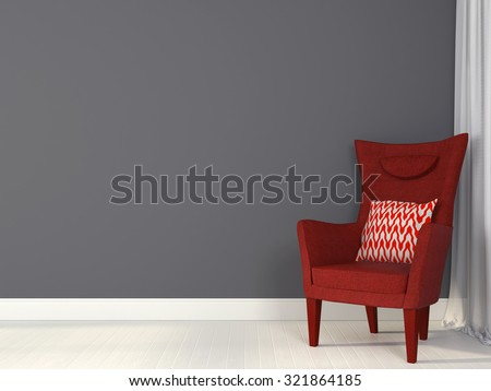 Modern red chair against a background of gray wall
