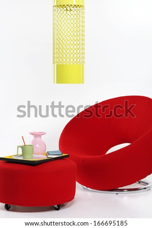 Modern red chair and a coffee table - stock photo