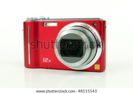 Modern red compact high zoom digital camera over white - stock photo