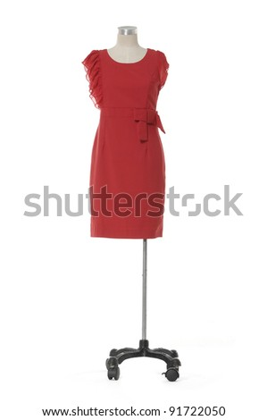 Modern red dress isolated on a mannequin - stock photo