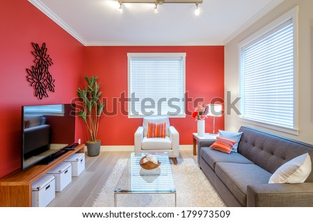 Modern red living room interior design - stock photo