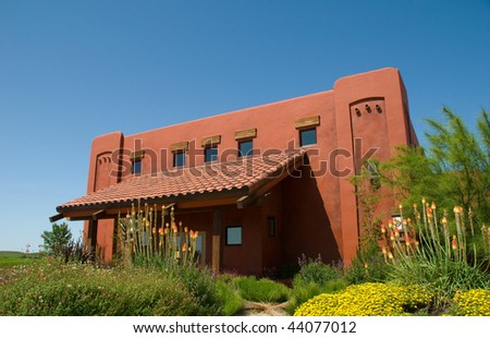 Modern Red Winery with Bright Blue Sky - stock photo