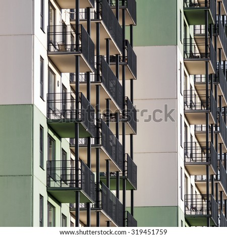 Modern residential building with balconies - stock photo