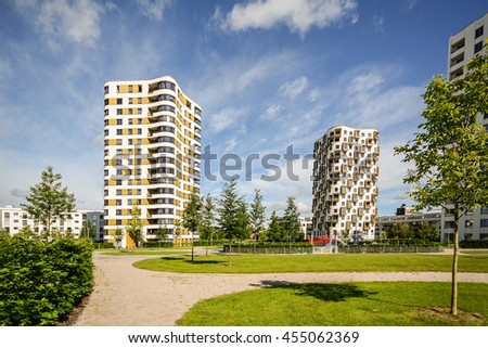 Modern residential buildings with outdoor facilities, Facade of new apartment towers - stock photo